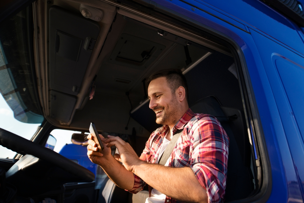 Truck Driver On Phone in Blue Truck
